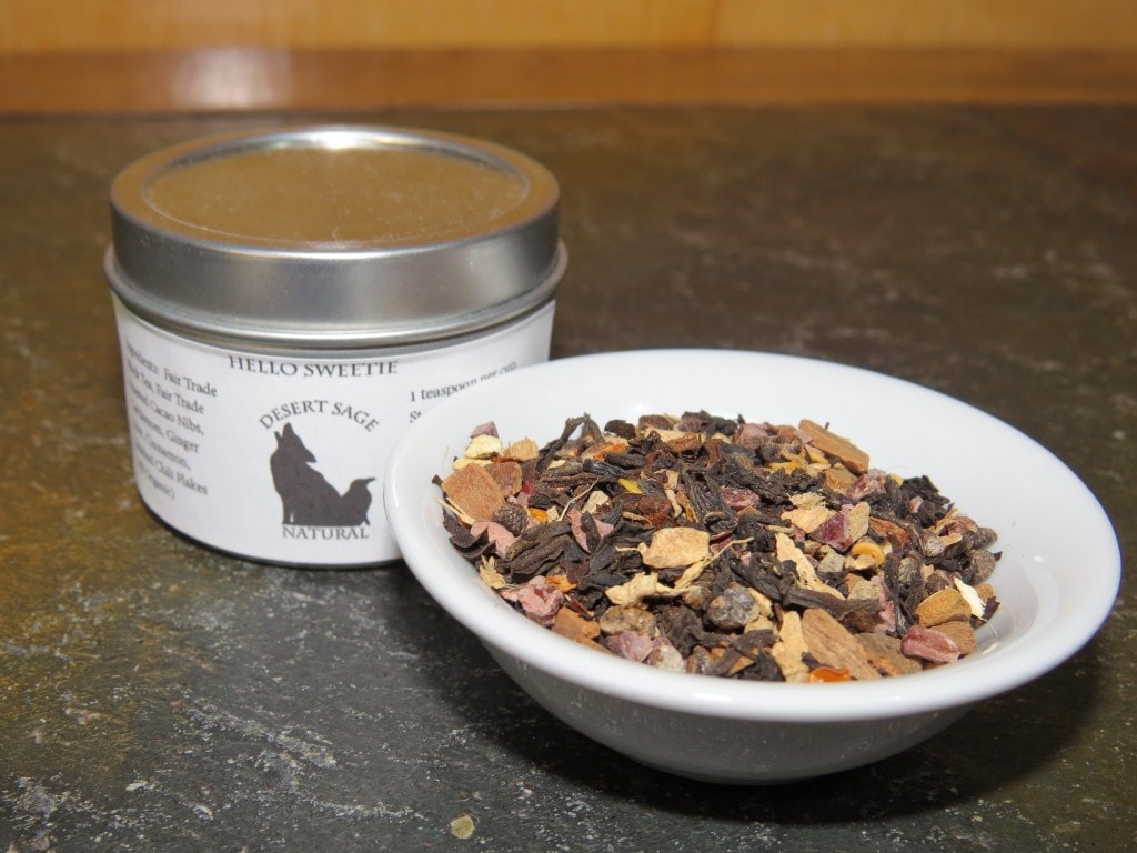 Sample Tin for 'Hello Sweetie' next to a small white bowl of the tea