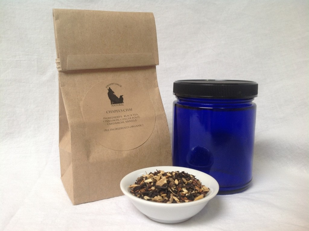 A tintie bag, blue glass jar, and a small bowl of vanilla chai.