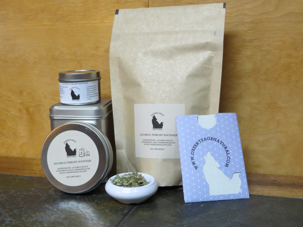 "A small white bowl full of medicinal herbs, surrounded by a variety of tea packaging. The labels have the Desert Sage Natural Logo and read: ""Licorice Throat Soother, Ingredients: Licorice, Cinnamon, Sage, Marshmallow LEaf, Marshmallow Root, (All Organic)"""
